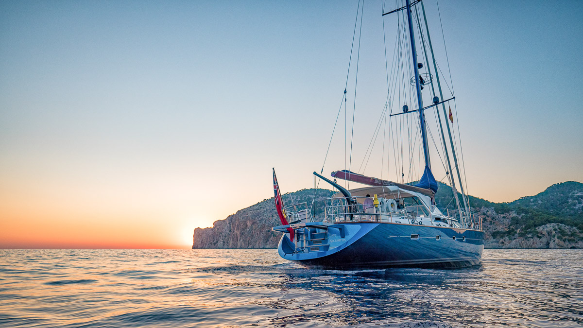 Sailing Yacht Oyster 82 at anchor during calm mediterranean sunset